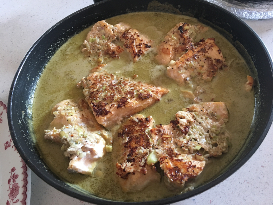 Delicious shore lunch - lemongrass crusted lake trout bathed in sauce in a cast iron skillet