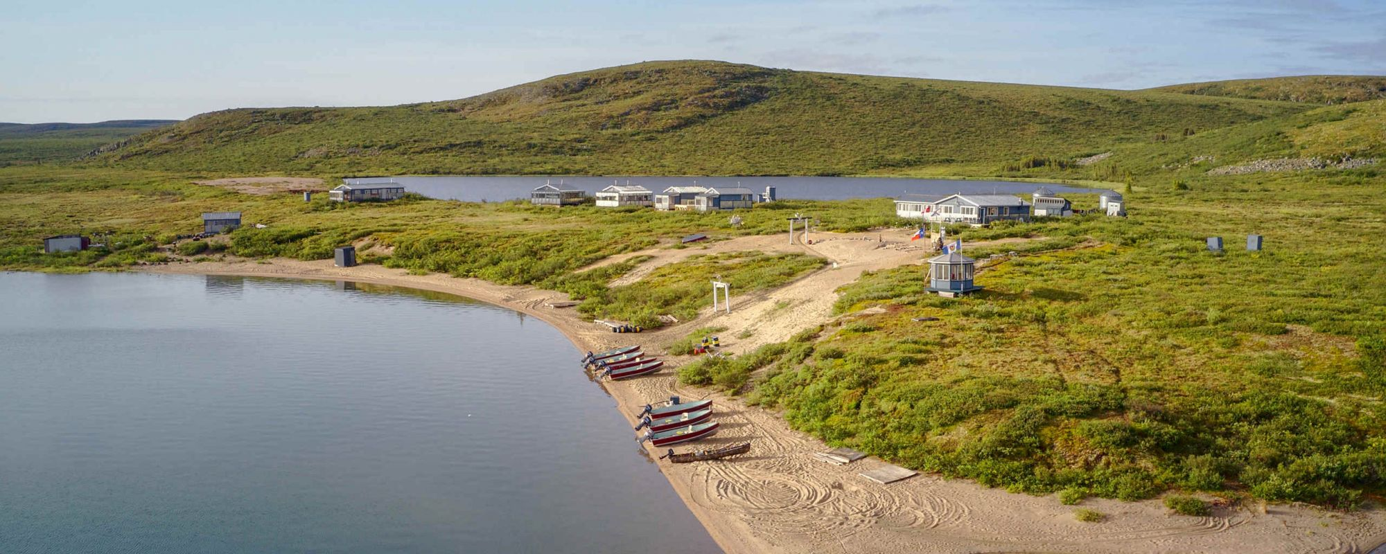 Lodge and boats on beautiful sand beach in the barrens