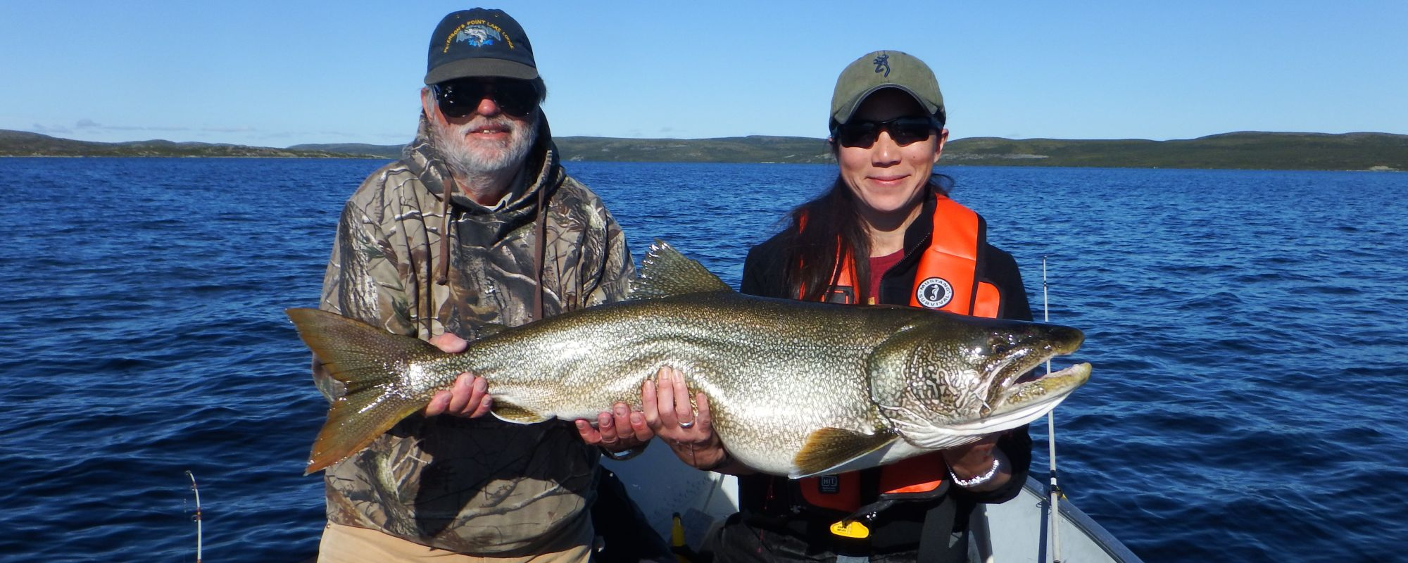 Two Anglers holding giant lake trout