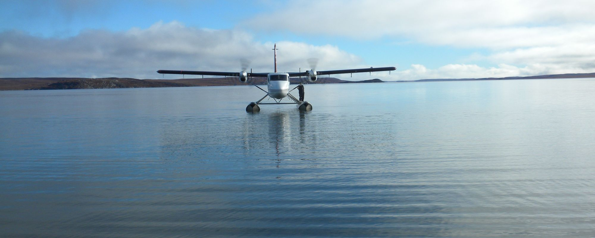 Twin Otter Float plane taxing on calm water